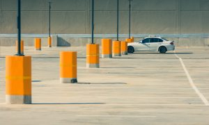 Parking lot seal coating with white car