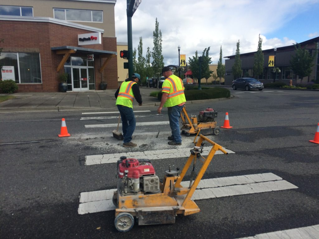 Stripe Rite employees remove pavement in Snoqualmie