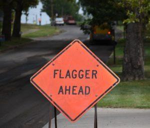 Flagger Ahead Warning Sign