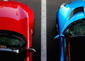 Red and blue car in a parking lot
