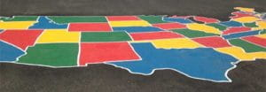 A colored map of the US marked on an asphalt playfield