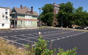 A parking lot after Stripe Rite applied a seal coat and re-painted
