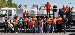 A Stripe Rite crew standing in front of a Stripe Rite truck